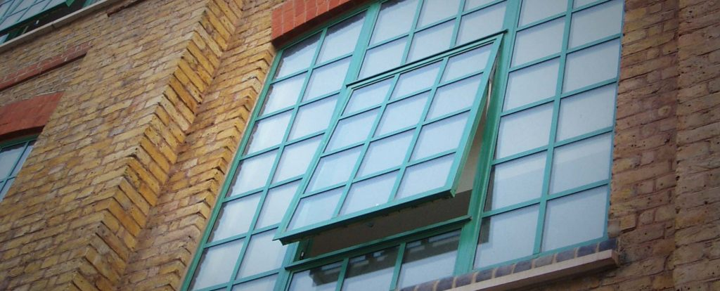Alitherm Heritage top hung and side hung steel look windows for traditional commercial building