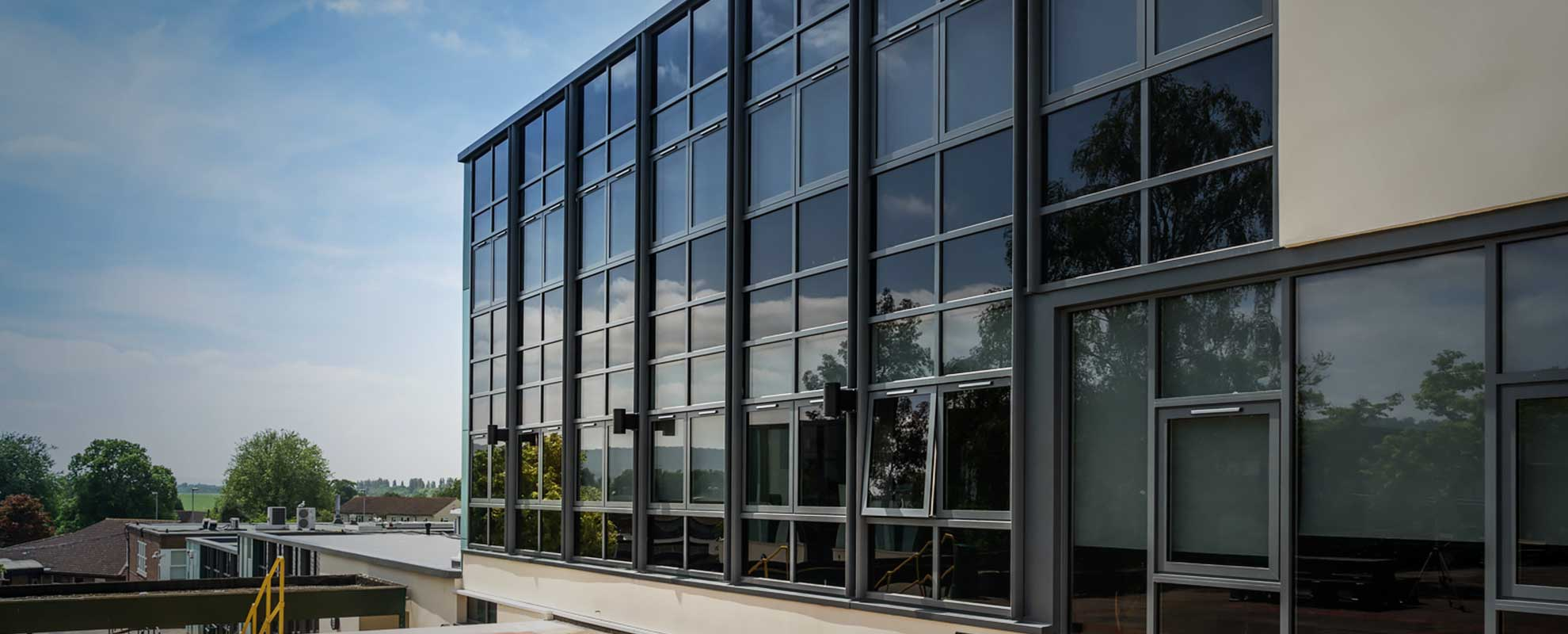 Black aluminium curtain wall with tinted glass